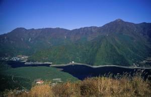 1280px-Lake_Sai_and_Aokigahara_from_Koyodai