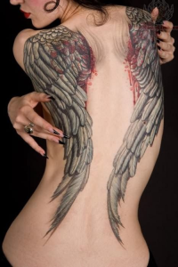 a-cool-back-or-wrist-tattoo-is-a-great-way-to-make-heads-turn-provided-you-choose-well.-enhance-your-coolness-factor-with-our-cool-tattoo-ideas-for-girls.
