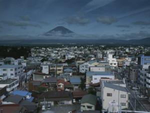 karen-kasmauski-mt-fuji-looms-on-the-distant-horizon-beyond-a-japanese-town