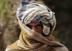 A former Taliban fighter looks on after joining Afghan government forces during a ceremony in Herat province on March 26, 2012. Twelve fighters left the Taliban to join government forces in western Afghanistan. The Taliban, ousted from power by a US-led invasion in the wake of the 9/11 attacks, announced earlier this month that they planned to set up a political office in Qatar ahead of talks with Washington. AFP PHOTO / Aref KARIMI (Photo credit should read Aref Karimi/AFP/Getty Images)