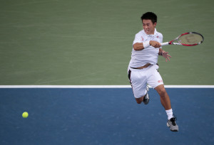 Kei Nishikori, of Japan, returns a shot against Stan Wawrinka, of Switzerland, during the quarterfinals of the 2014 U.S. Open tennis tournament, Wednesday, Sept. 3, 2014, in New York. (AP Photo/Julio Cortez)